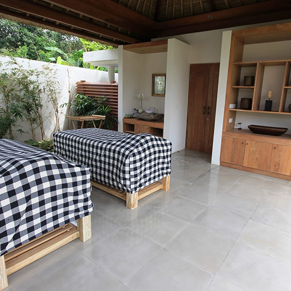 Enjoy a couples massage at Villa Pantai, a beachside resort on Nusa Lembongan