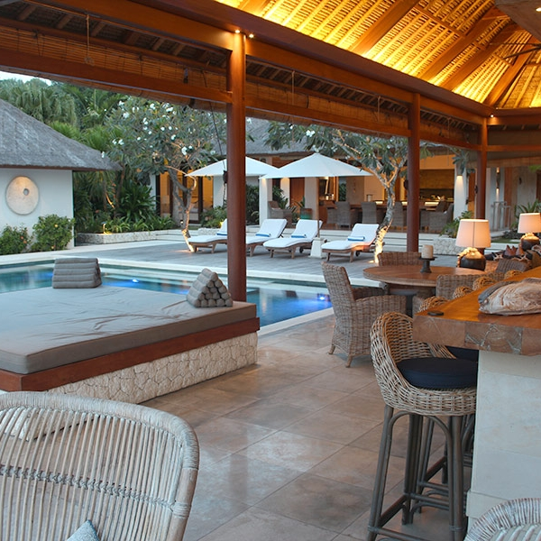 The spacious living pavilion is a great place to relax by the pool